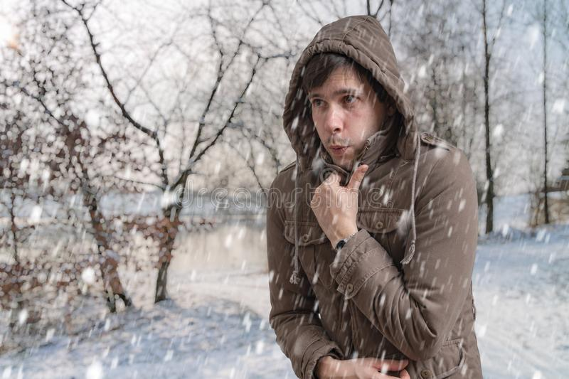 Man is freezing outside in cold winter.  stock photo