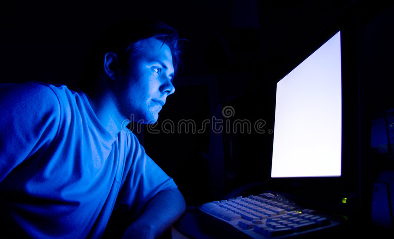 Man in front of computer royalty free stock photos