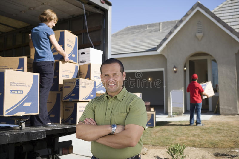 Man In Front Of Delivery Van And House royalty free stock image