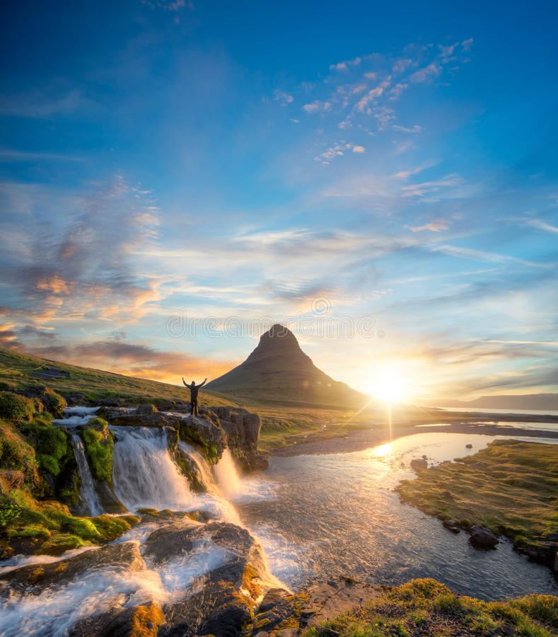 Man in front of Kirkjufell mountain, Iceland stock image