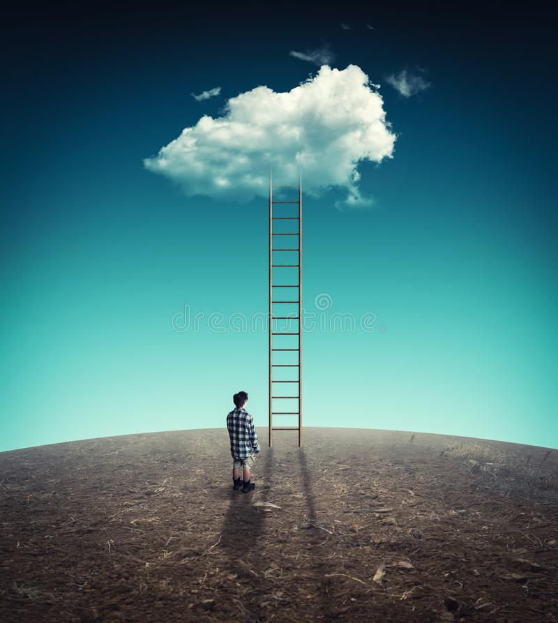 Man in front of a ladder to a cloud royalty free stock photos