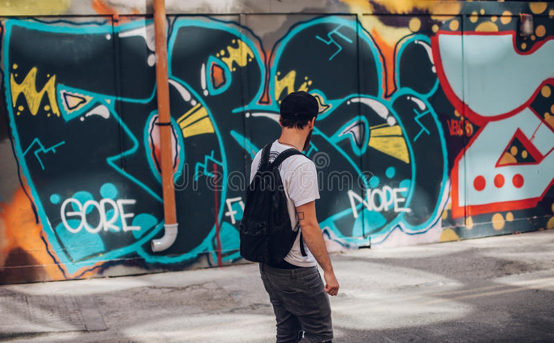 Man In Front Of Wall With Graffiti Free Public Domain Cc0 Image