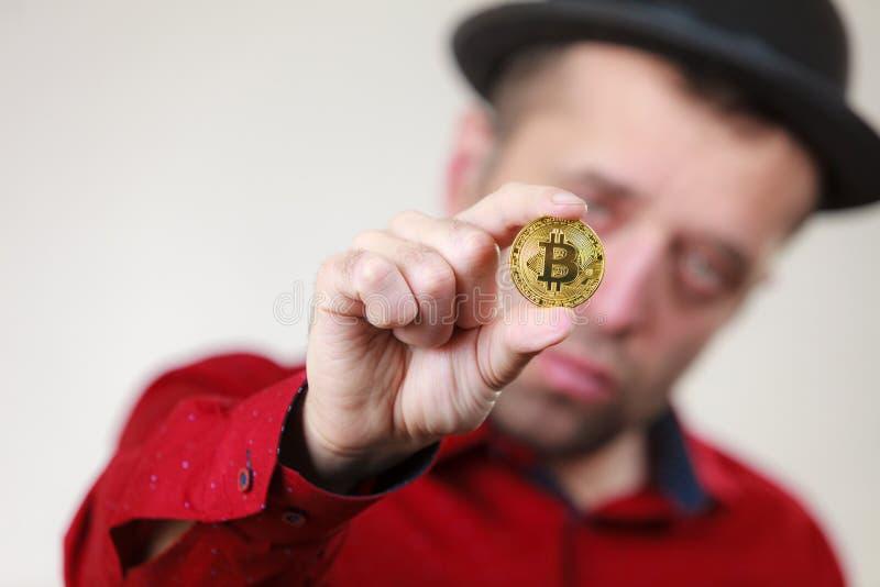 Man holding golden bitcoin stock photo