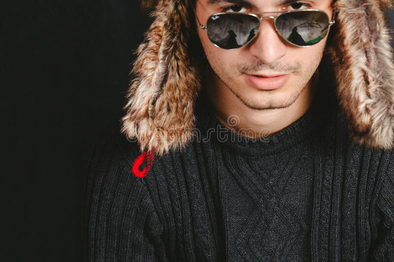 Man with furry hat and sunglasses royalty free stock photography