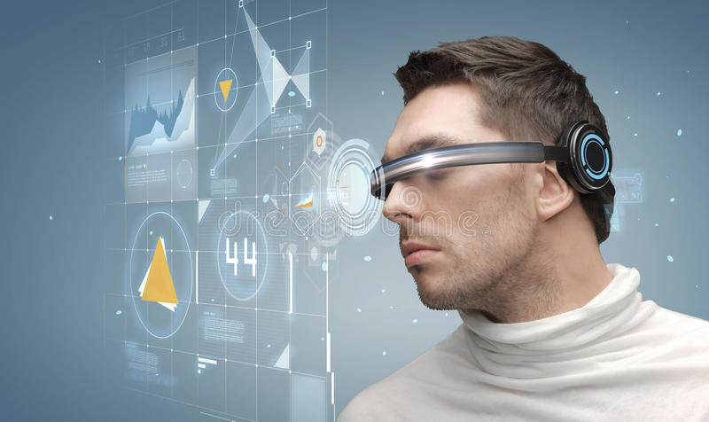 Man in futuristic glasses. Future, technology, business and people concept - man in futuristic glasses royalty free stock images