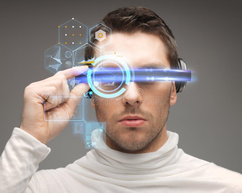 Man in futuristic glasses. Future, technology and people concept - man in futuristic glasses stock images