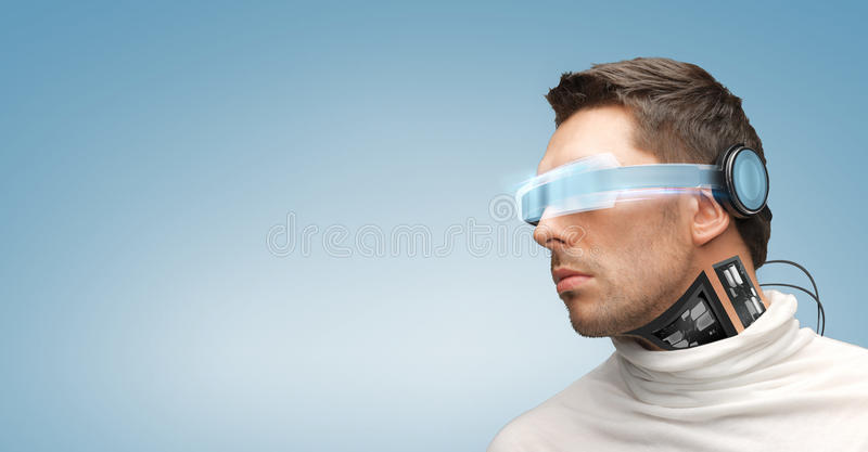 Man with futuristic glasses and sensors royalty free stock image