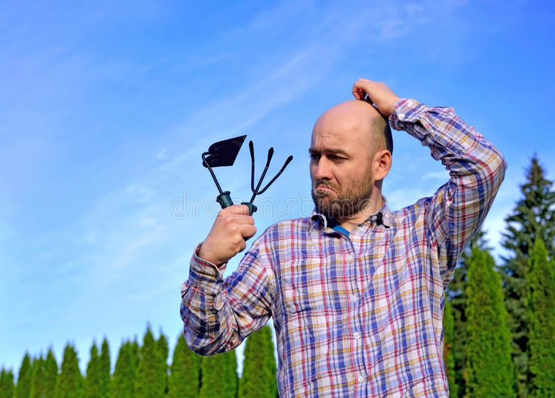 Man with garden tools. In park royalty free stock photo