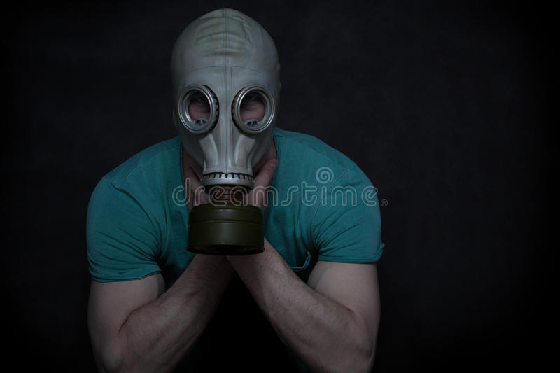 A man in a gas mask stock images