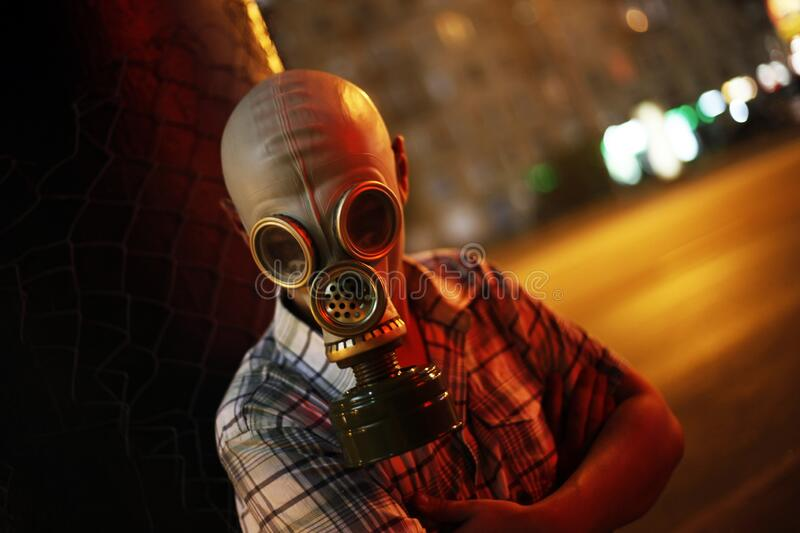 Man in a gas mask on night street.  royalty free stock photography