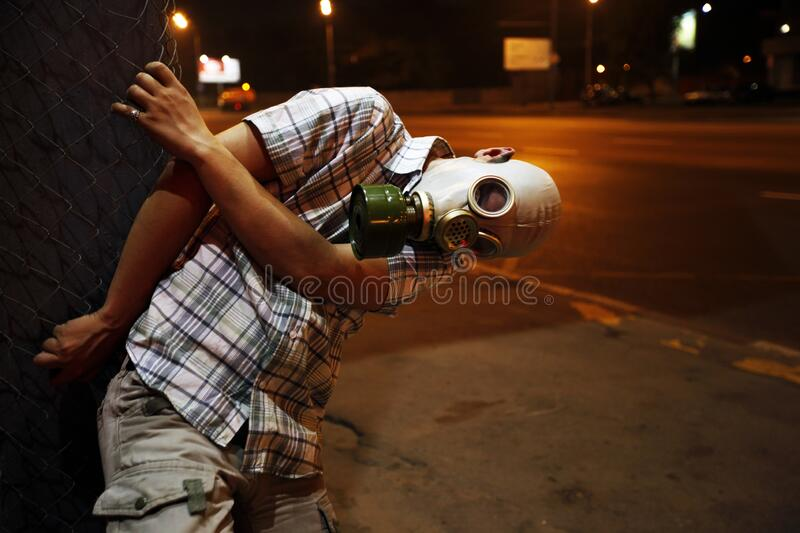 Man in a gas mask on night street.  royalty free stock photos