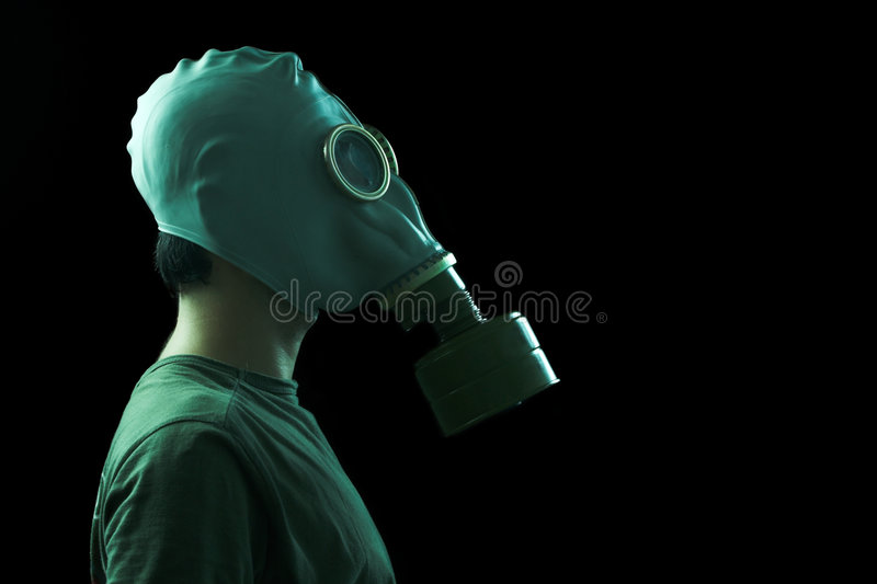 Man with gas mask profile stock images