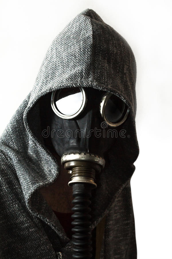 Man Gas Mask. Scary man wearing authentic Russian gas mask with breathing hose stock image