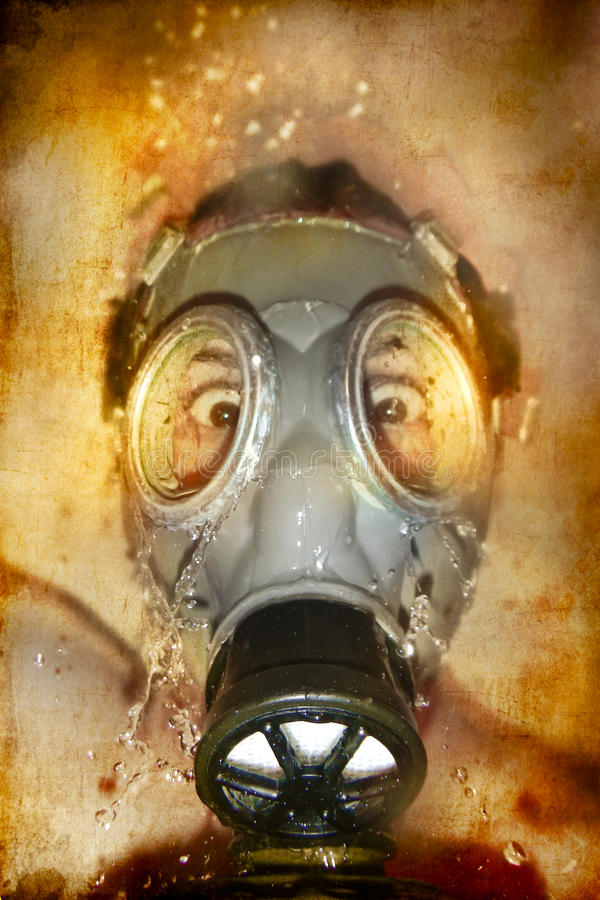Man in gas mask with water reflection in the eyes. Naked man with hands on his head royalty free stock photos