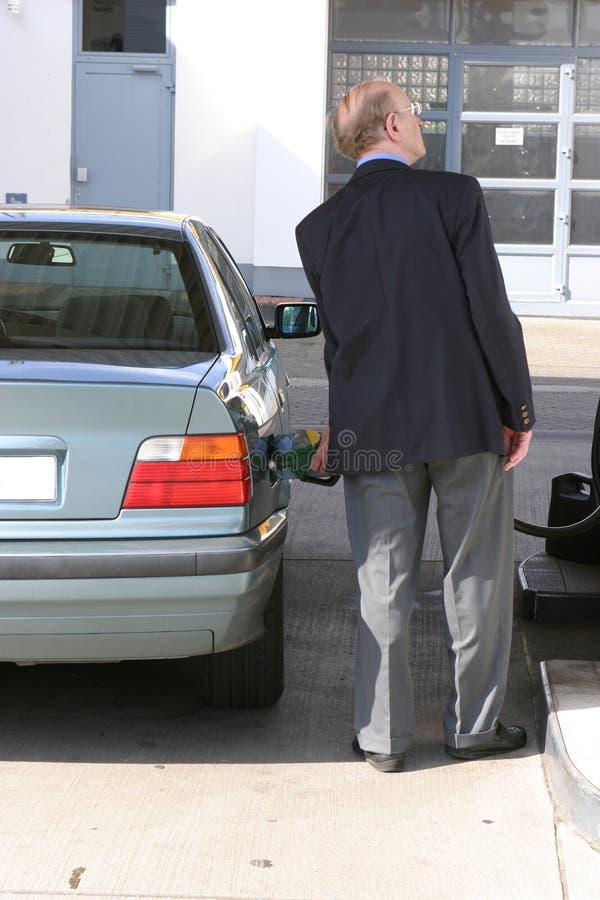 Man at Gas station stock image