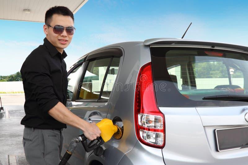 Man at gas station stock photo