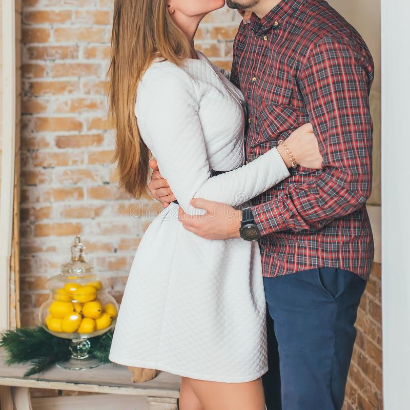 The man gently hugs the girl and presses her to him stock photos