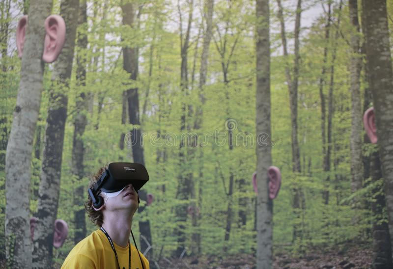 Vr devices testing at sonar Barcelona. A man gestures on a forest background while wearing virtual reality VR equipment during Sonar advanced technology music royalty free stock photos