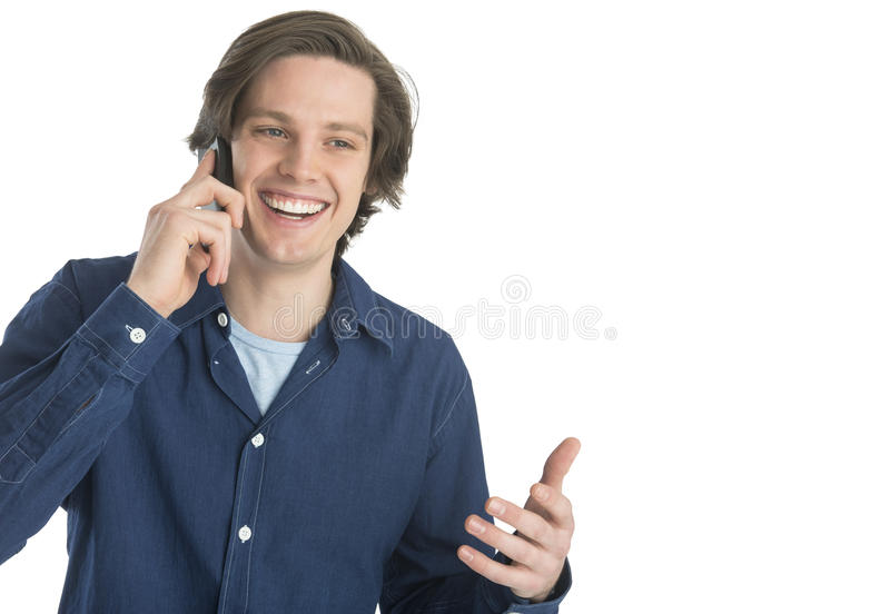 Man Gesturing While Answering Smart Phone Stock Photo