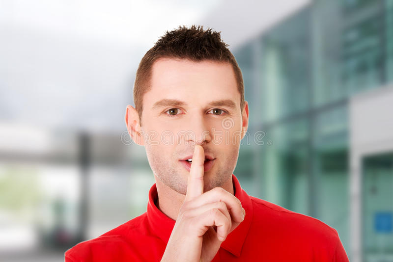 Man gesturing to be quiet. With finger royalty free stock photography