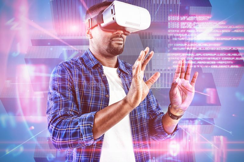 Composite image of man gesturing while using virtual reality headset stock image