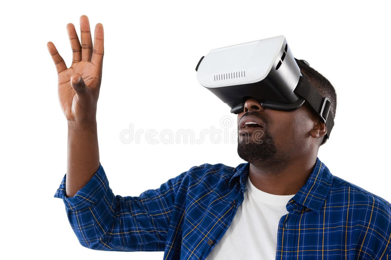 Man gesturing while using virtual reality headset stock photo