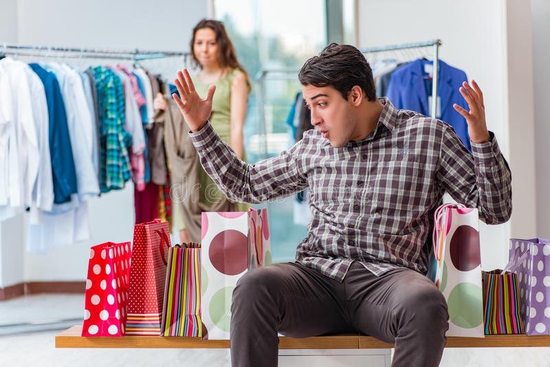 The man getting into debt due to shopping. Man getting into debt due to shopping stock images