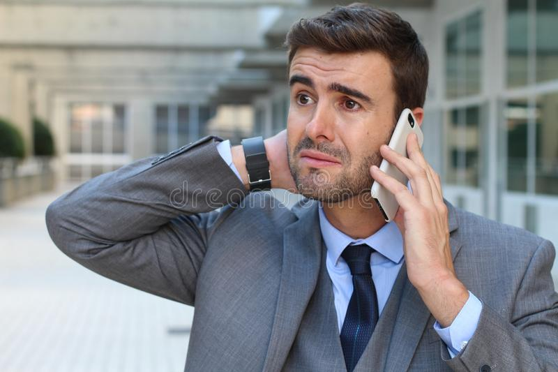 Man getting devastating news on a phone call.  royalty free stock images