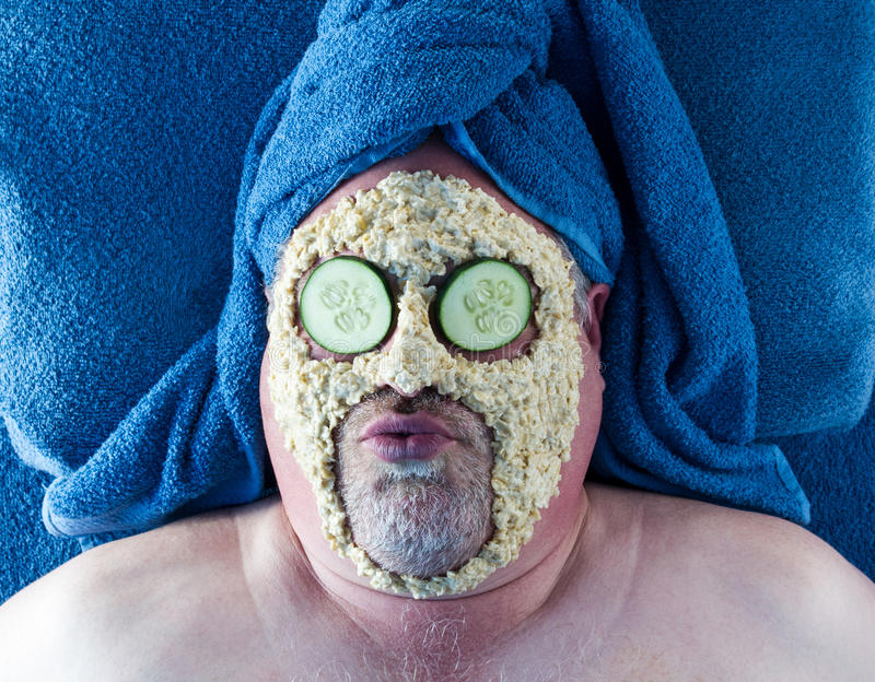 Man Getting Facial With Silly Facial Expression stock images