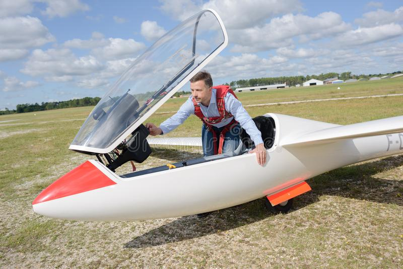 Man getting into glider royalty free stock photos
