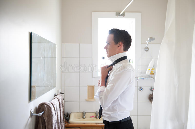 Man getting ready for a special day. Best man getting ready for a special day royalty free stock photos
