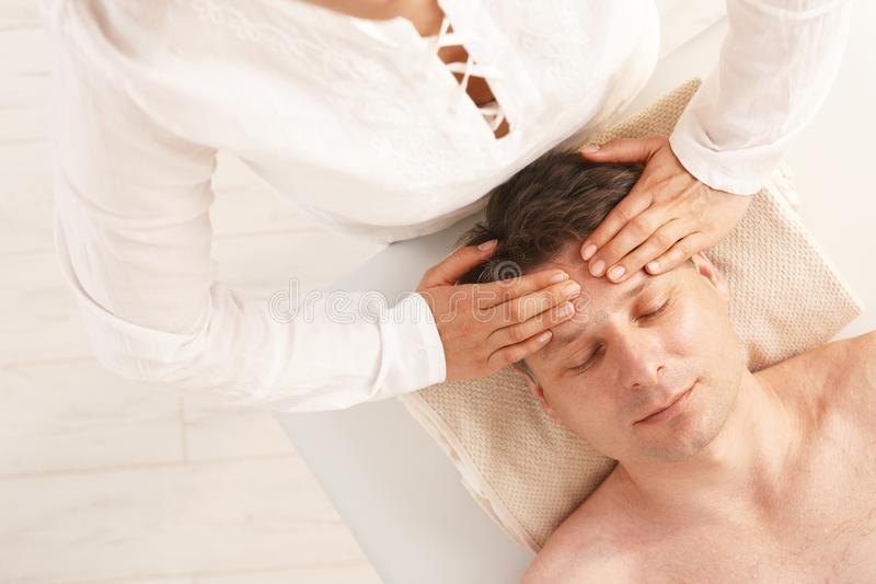 Man getting relaxing head massage. In dayspa stock image