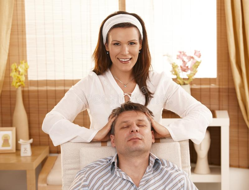 Man getting relaxing head massage. In dayspa royalty free stock photography