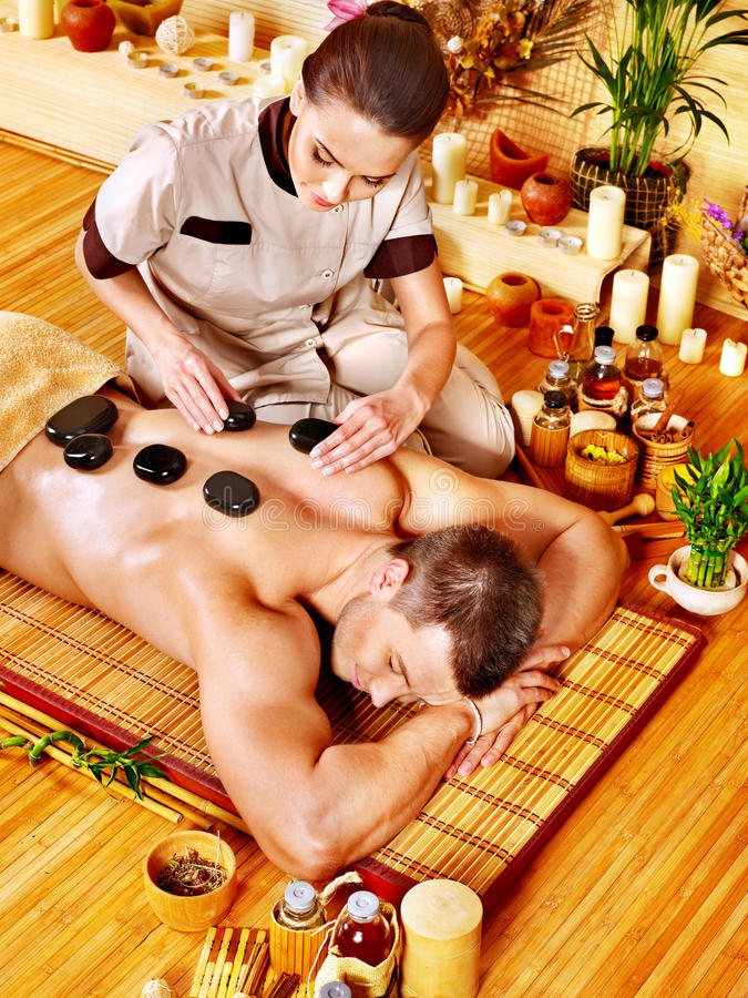 Download Man Getting Stone Therapy Massage . Stock Image - Image: 27677825