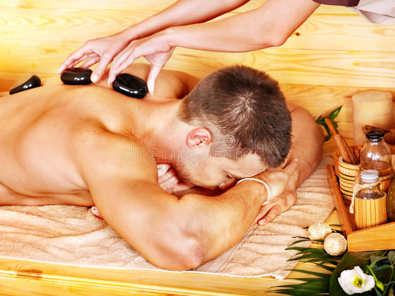 Download Man Getting Stone Therapy Massage . Stock Image - Image: 28031655