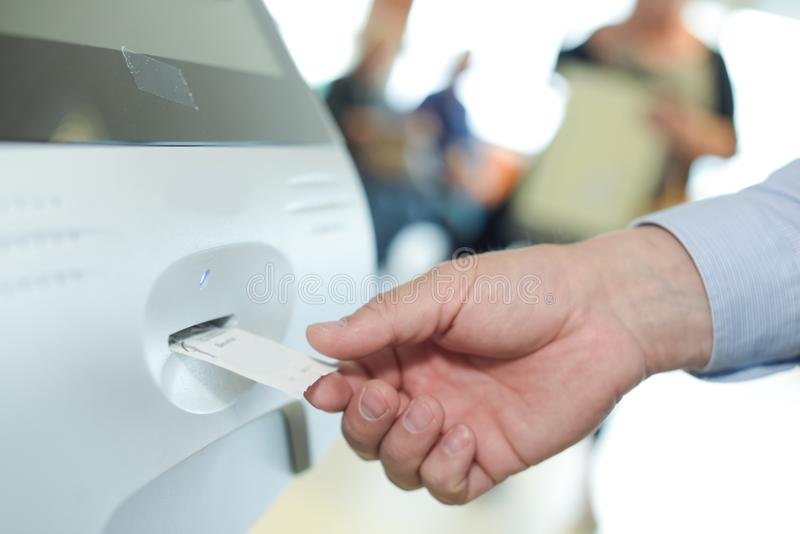 Man getting ticket from machine stock photography