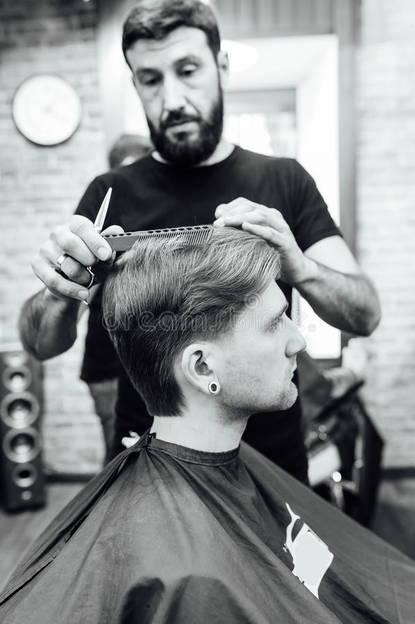 Man Getting Trendy Haircut At Barber Shop Stock Photo Image Of