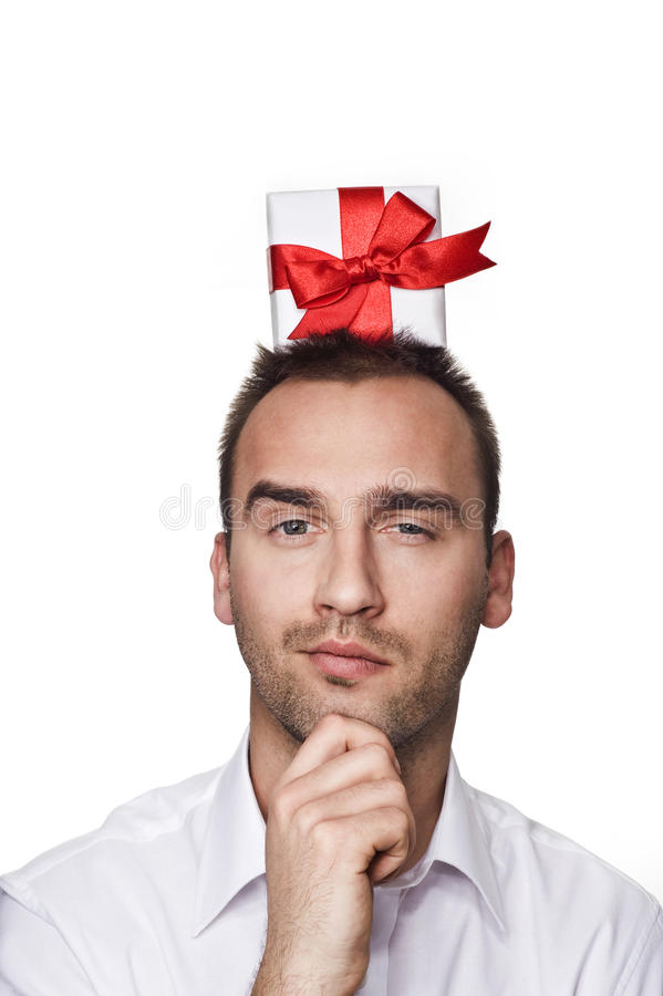 Man with a gift on his head royalty free stock images