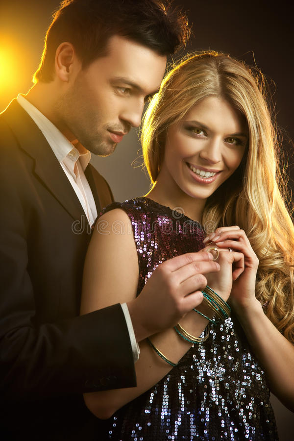 Man gifting a ring. Happy young man gifting a ring to a beautiful young woman