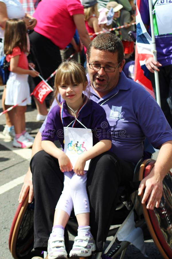 Man and girl in a wheelchair in carnival royalty free stock photo