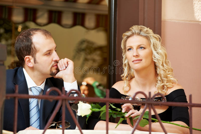 Man and girl with wine at cafe on royalty free stock photography
