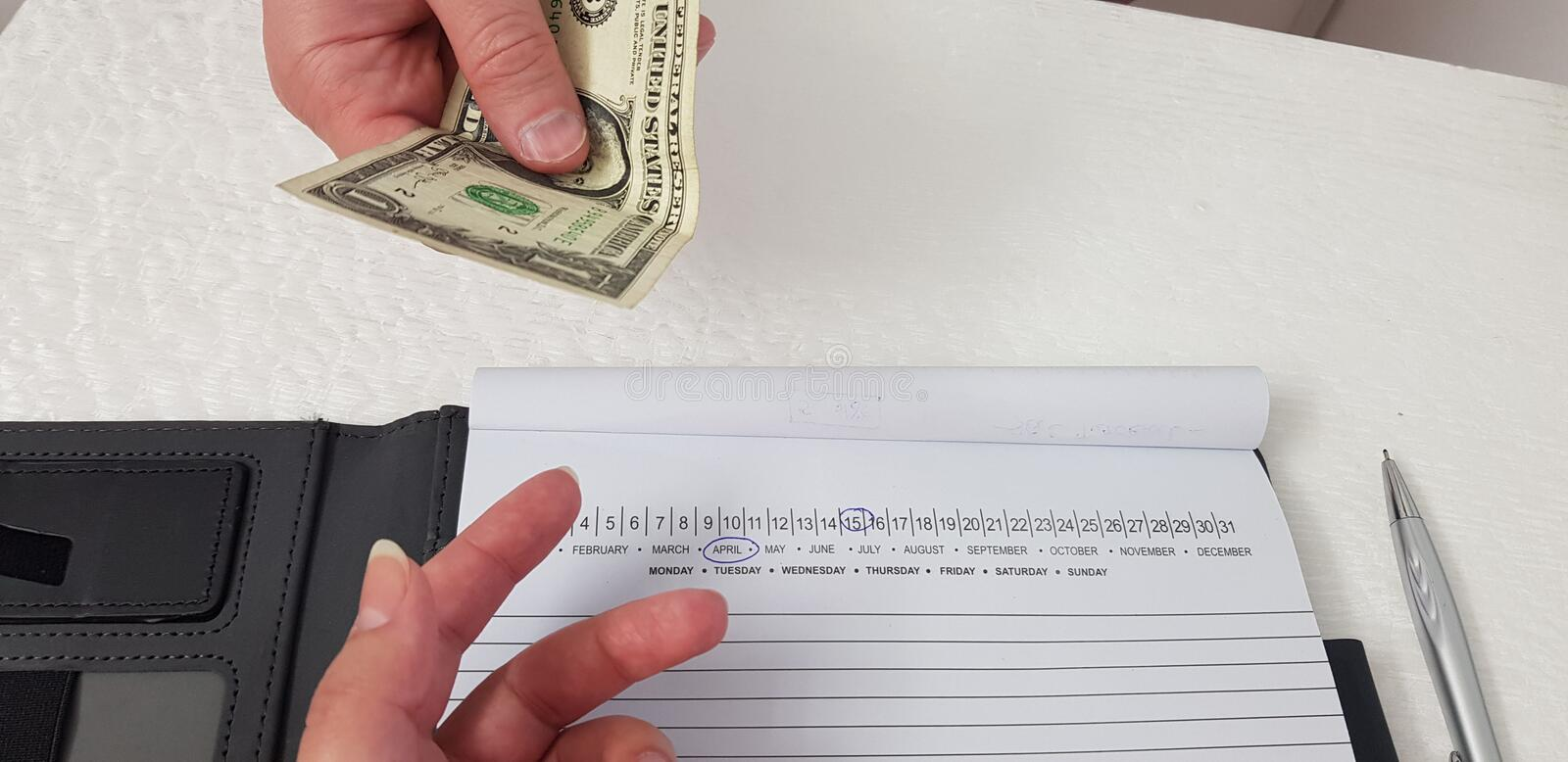 Man gives one dollar bill to a woman hand stock photos