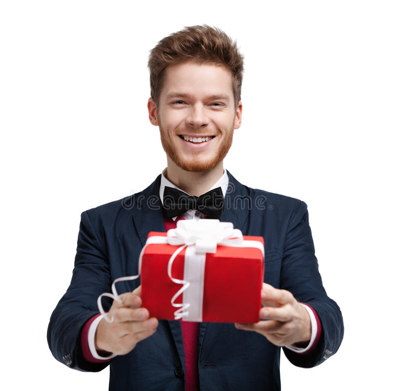 Man gives a present. Wrapped in red gift paper, isolated on white royalty free stock photo