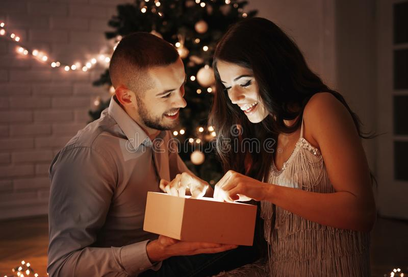 Man giving a Christmas present to his girlfriend royalty free stock image