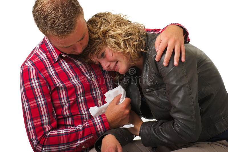 Man giving comfort to young woman royalty free stock photos