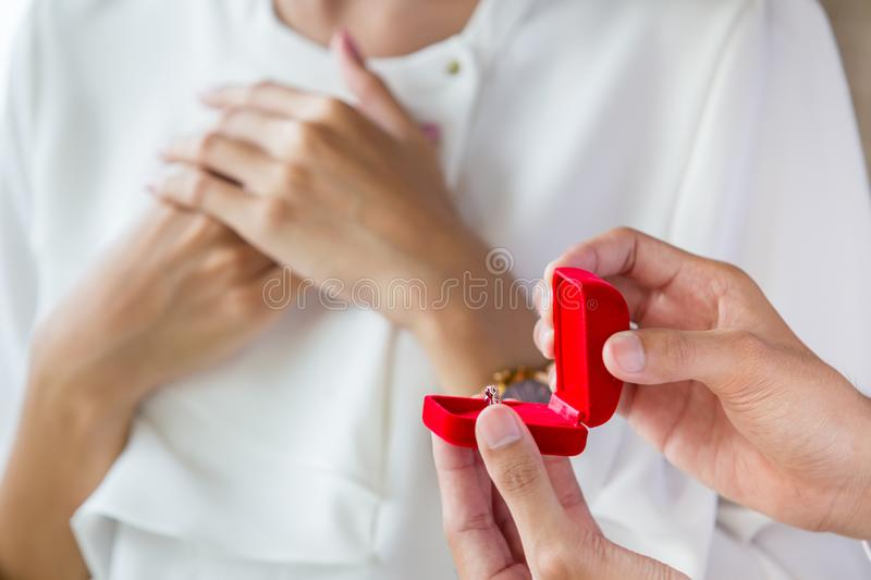 Man surprise his girlfriend with the ring stock photos