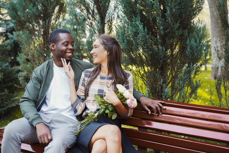 Man giving flowers for his beautiful girlfriend stock photo
