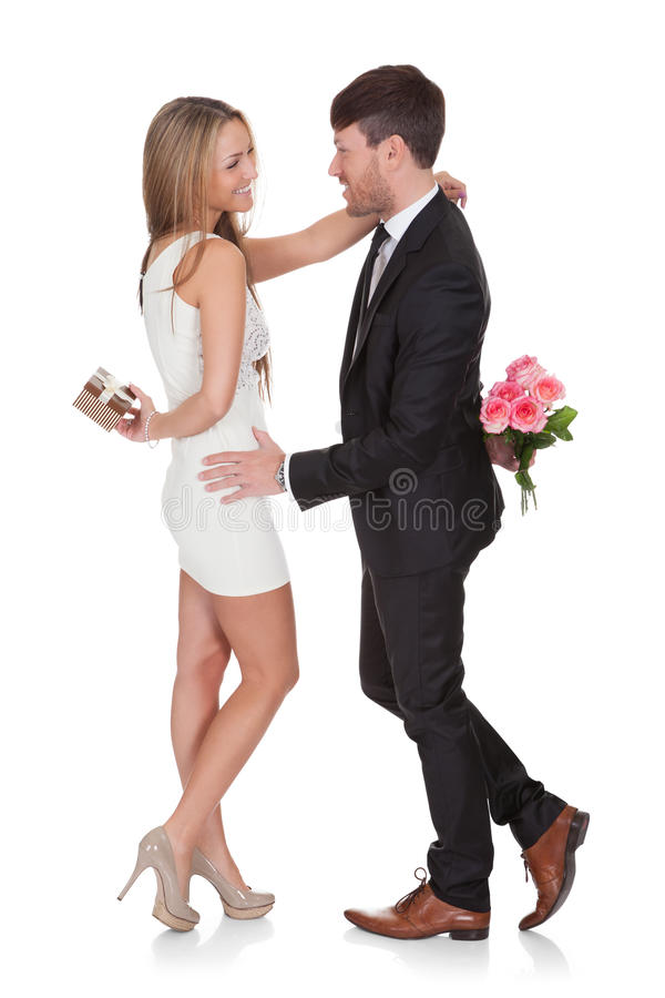 Download Man Giving Fresh Flowers To Woman Stock Photo - Image: 29674132