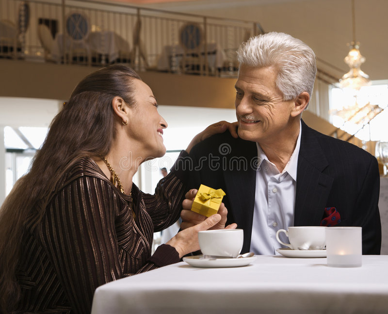 Man giving gift to woman royalty free stock images