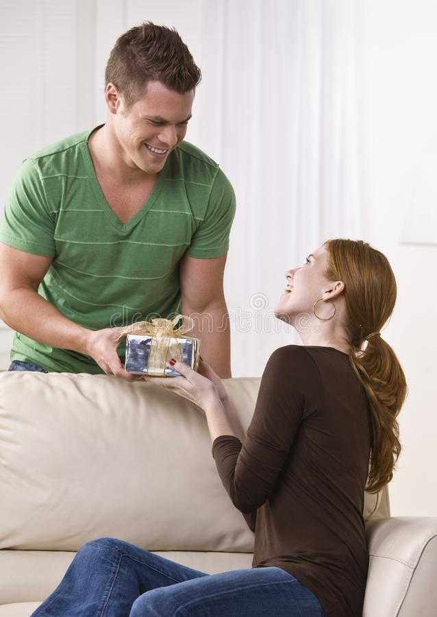 Man Giving Gift to a Woman. royalty free stock photo